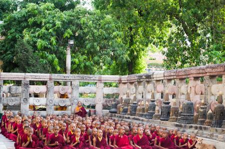 gaya: BODHIGAYA - INDIA, MAY 11, 2014: Tibetan buddhist monk and novices  pray the Buddhism ritual on 11 May 2014 , Gaya , India Editorial