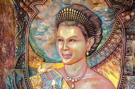 BANGKOK ,THAILAND - 9 JULY 2014 : masterpiece of traditional Thai  style sculpture on the wall of church of Wat Rama 9 Kanchana Pisek ,Portrait of Thai Queen Sirikit ,   Bangkok Thailand Editorial