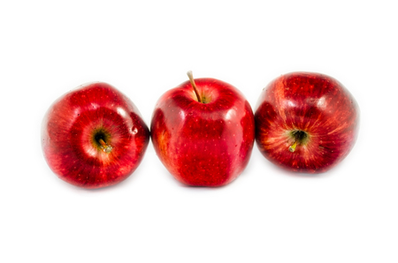 lied: tree red apples in different put lied on