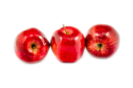 lied: tree red apples in different put lied on white background isolated Stock Photo
