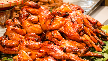 Hot grilled chicken  Thai North East style  in gourmet market