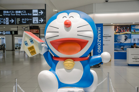 animation teenagers: Supporo ,HOKKAIDO JAPAN - 24 JULY 2014   A Doraemon mascot model for attract tourism at Chitose international Airport in Hokkaido   Doraemon is the most famous character in Japanese animation and comic by Hikari Fujimo  Fujiko F  Fujiko as pen name
