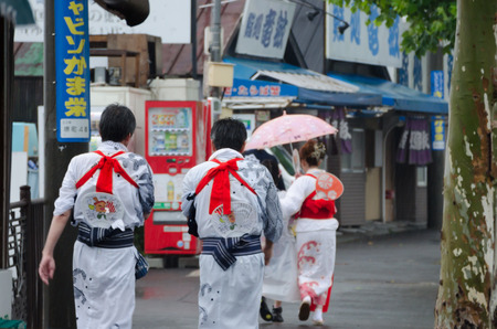 HOTARU ,HOKKAIDO, JAPAN -26 JULY 2014  Lots of unidentified  people with Kimono  Japanese traditional clothes  around the town with rain in Hotaru town , Hokkaido, Japan  Editorial