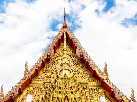 bell curve: gable apex of church in a temple, roof with nice sky at Wat Mahaeyong ,Nakhon Si Thammarat , Thailand