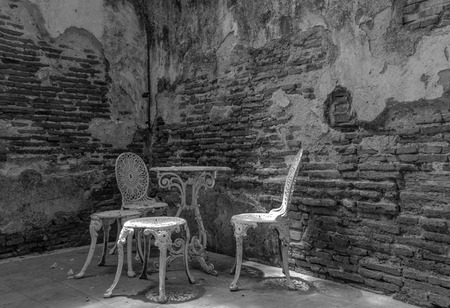 Garden furniture set with old brick wall black and white version photo