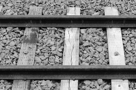 old railway on gravel blue stone black and white version photo