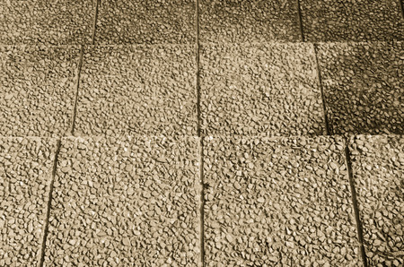 Gravel stone sand staircase in the park black and white sepia tone photo