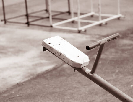 seesaw board closeup retro vintage on playground in sepia color photo