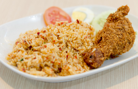 Fried Rice with Roast Chilli Paste Served with Fried Chicken Leg and boil Egg in Thai style traditional food photo