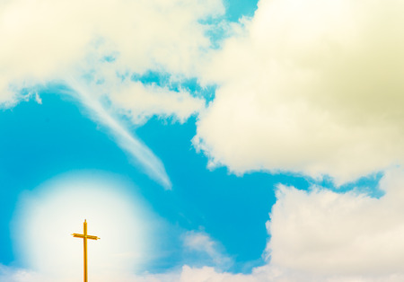 radiated: Blue Sky with warm light radiated from Christian Cross
