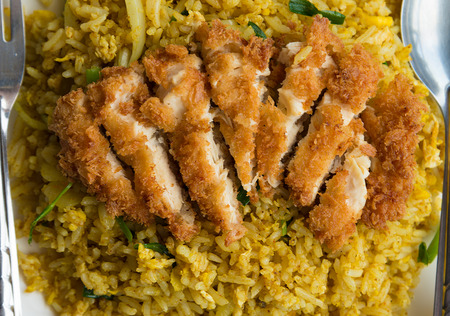 Fried Rice with Crispy  Chicken ,Thai food on dish closeup photo