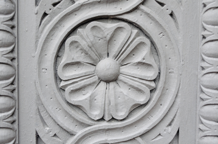 Decoration flower stone sculpture on the wall photo