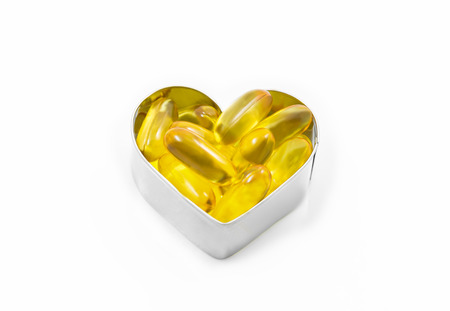 Fish Oil macro in hear shape box isolated on white background photo