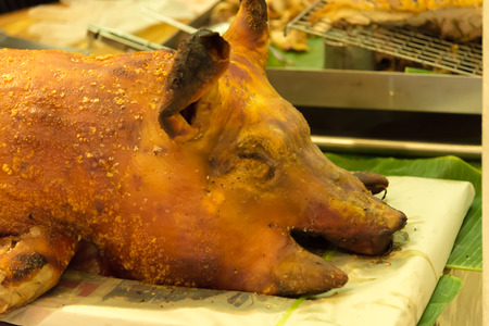 skinning: Grilled pork head closeup in the market