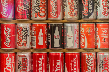 Bangkok, Thailand - September 13,2014 : Collection of aluminum cans of Coca Cola famous drink brand in various design include Coke Light,Coke Zero and special edition for etc. Editorial