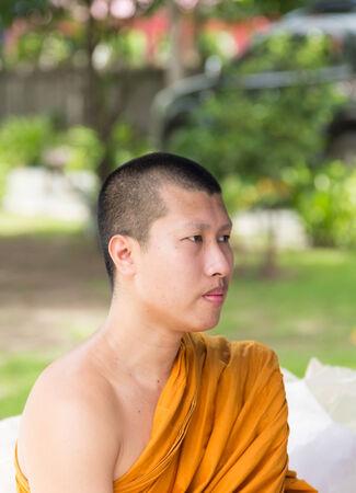 sit around: Bangkok , Thailand - September 21, 2014:  An unidentified Thai monkr sit around exterior  around Wat Rajadhivas Temple in Dusit Area ,  Bangkok Thailand