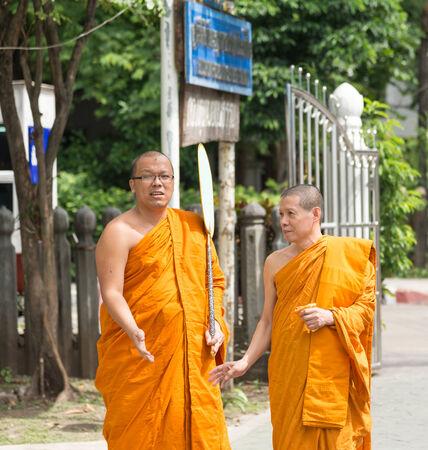 sit around: Bangkok , Thailand - September 21, 2014:  Two unidentified Thai monks sit around exterior  around Wat Rajadhivas Temple in Dusit Area ,  Bangkok Thailand Editorial