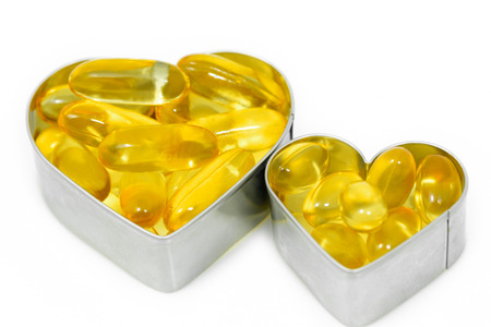 Two Heart Boxes contain fish oil pills isolated on white background photo