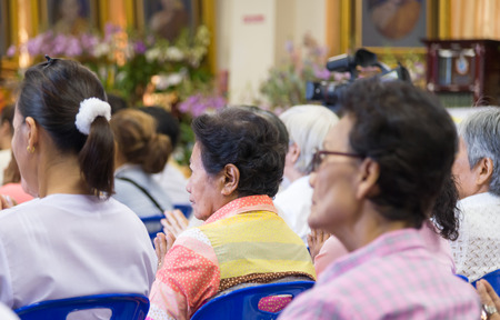 sit around: Bangkok , Thailand - September 21, 2014:  Unidentified Thai Buddhist people sit around indoor  for listen to Dhamma of Buddhism from monks at Wat Rajadhivas Temple in Dusit Area ,  Bangkok Thailand