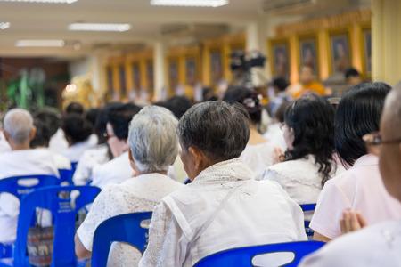 dhamma: Bangkok , Thailand - September 21, 2014:  An Unidentified Thai Buddhist nun sit around indoor  for listen to Dhamma of Buddhism from monks at Wat Rajadhivas Temple in Dusit Area ,  Bangkok Thailand Editorial