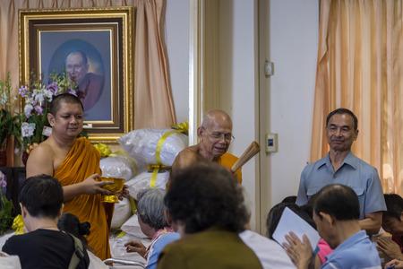 sit around: Bangkok , Thailand - September 21, 2014:  Unidentified Thai Buddhist people sit around indoor  for the holy water from abbot in buddhism ritual at Wat Rajadhivas ,Bangkok Thailand