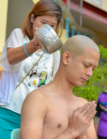ordain: Bangkok, Thailand - October 25, 2014 :An Thai male sit for Buddhism  ordain ritual with his family at Wat Thapra Temple in Thonburi Area  Bangkok, Thailand