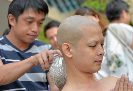 ordain: Bangkok, Thailand - October 25, 2014 :An Thai male sit for  ordain ritual with his family at Wat Thapra Temple in Thonburi Area  Bangkok, Thailand Editorial