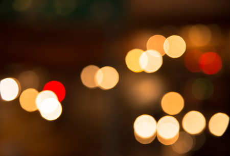 Blur bokeh traffic light in urban at night background