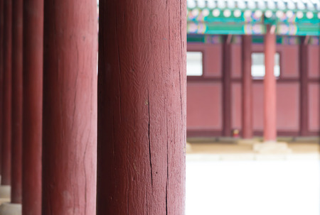 historic place: Row of Poles closeup inside  Gyeongbokgung Palace , Famous historic place in Seoul South Korean Stock Photo