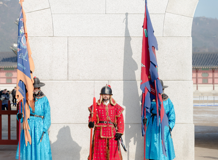 unknown men: Seoul, South Korea - December 31,2014 : Unknown men in ancient Korean soldier costume around Gyeongbokgung palace  for tourist attraction  in Seoul, South Korea