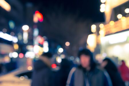 Blur defocused of urban scene at night with walking people Stock Photo