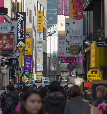 Seoul, Republic of Korea - December 31, 2014 : Myeongdong district ,famous shopping street in Seoul capital of South Korea, with crowd walking people  around