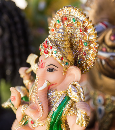 god figure: Ganesh ,elephant god, figure closeup focused on face