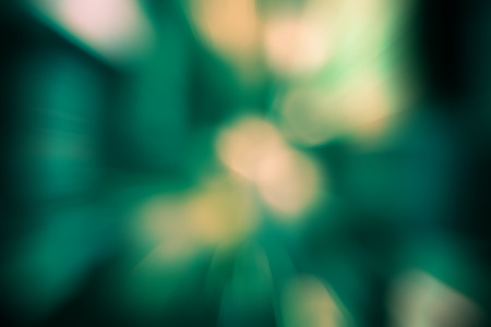 light zoom: Burst zoom of bokeh light in gradient green and yellow background