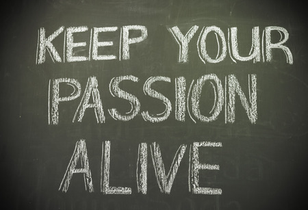 The Message of keep your passion alive written in white chalk on blackboard
