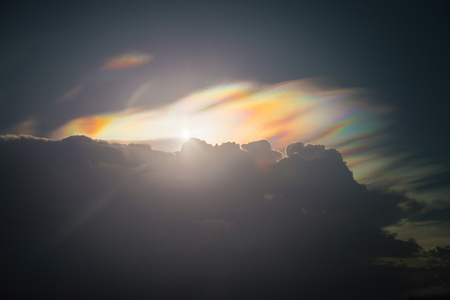 Beautiful sunset with rainbow cloud and spectrum light loo like angels wing