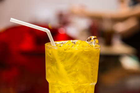 relive: Ice chrysanthemum juice Chinese tradition soft drink on glass with white straw