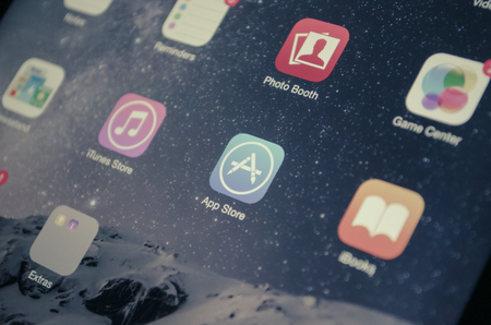 app store: Bangkok, Thailand - June 17, 2015  : A closeup photo of Apple iOS start screen focused on App Store application  icon on iPad mini 2 Device