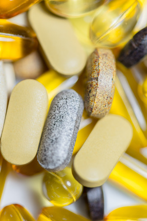 multivitamin: Food supplements pills or capsules drugs macro consist of fishoil , ,multivitamin,fruit and vegetable extract tablet ,lutein and else