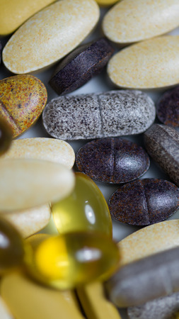 food supplement: Many kind of food supplement tablets and capsules pills macro closeup
