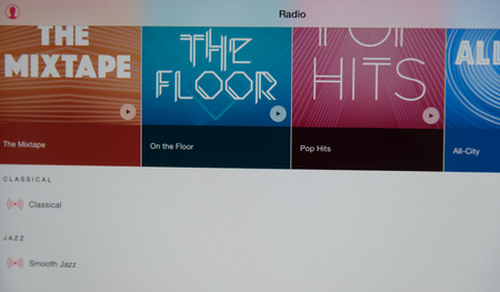 joining services: Bangkok, Thailand - July 2, 2015 : Screen of  Apple tablet show screen of Apple Music new music streaming from Apple Inc.