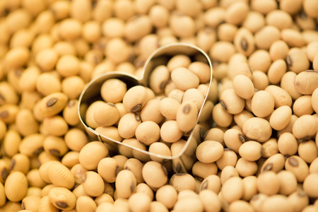 Soy beans in heart box shape among soy beans background