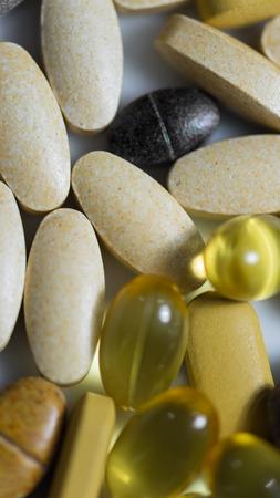 multivitamin: Multivitamin  and fish oil tablets  macro focused on vitamin tablets
