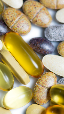 food supplement: Mixed food supplement pills macro such as  fish oil capsules, vitamin pills , lutein tablet etc. Stock Photo