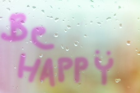 be wet: Mirror with rain drop in building multi color pastel tone with the word write 'Be Happy :)'