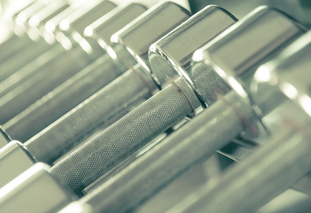 heavy weight: Steel dumbells closeup in creamy tone Stock Photo