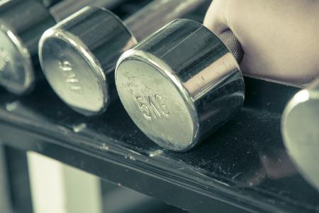 dumbell: Asian male  hand grab dumbell  focused on 5 kg one