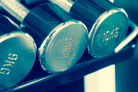 kg: Rusty steel dumbells closeup on 10 kg one  Stock Photo