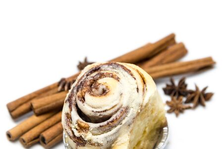 roped: Mini cinnamon rolls with roped cinnamon stick and star anise isolated on white background Stock Photo