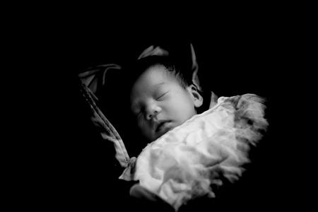 asian baby girl: Asian Thai baby sleeping on stroller  closeup black and white low key tone Stock Photo